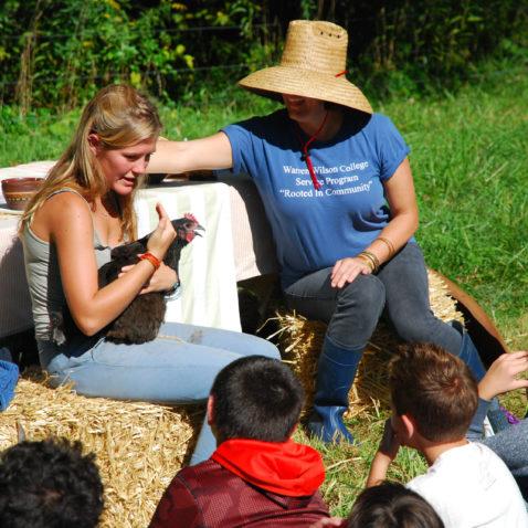 Student teaching children outdoors