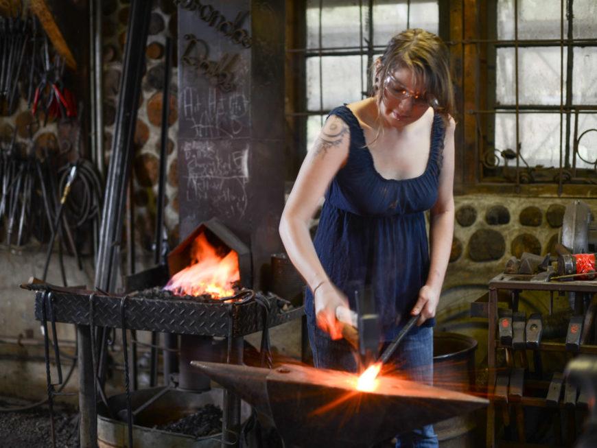 blacksmithing student