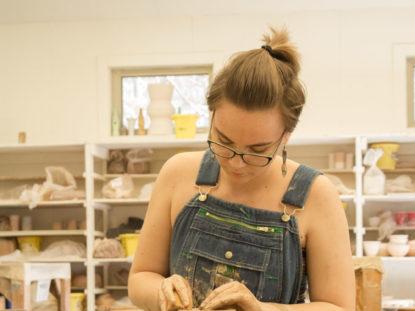 student doing ceramics