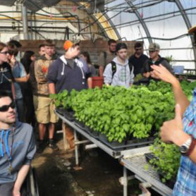 Mary Bulan with a class in the greenhouse