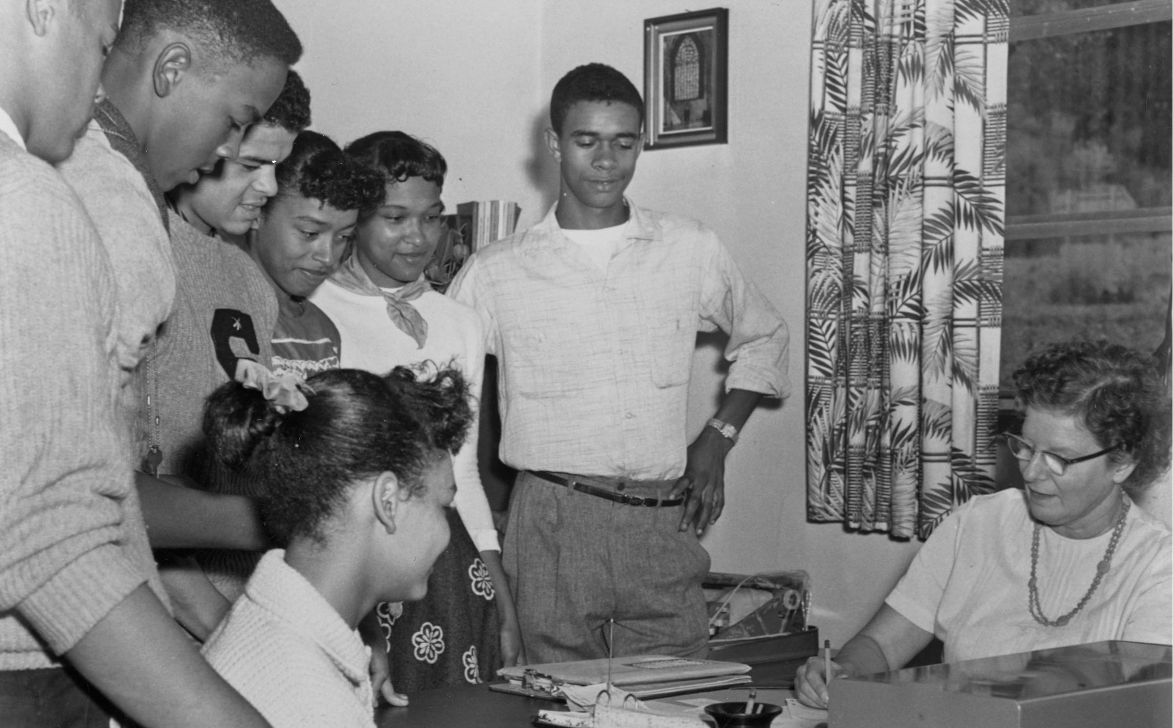Archival photo of black students registering for classes in the 1950s