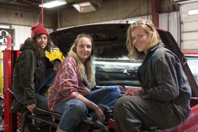 Warren Wilson College senior Savannah Livengood and sophomores Charlotte Surface and Corinna Steinrueck created an event to help women, transgender and non-binary campus community members gain basic car maintenance and repair skills.
