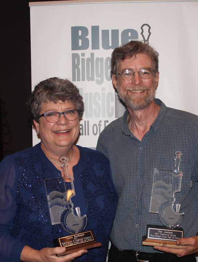 Warren Wilson College math and music professor Phil Jamison and alumna Laura Boosinger celebrate their induction into the Blue Ridge Music Hall of Fame.