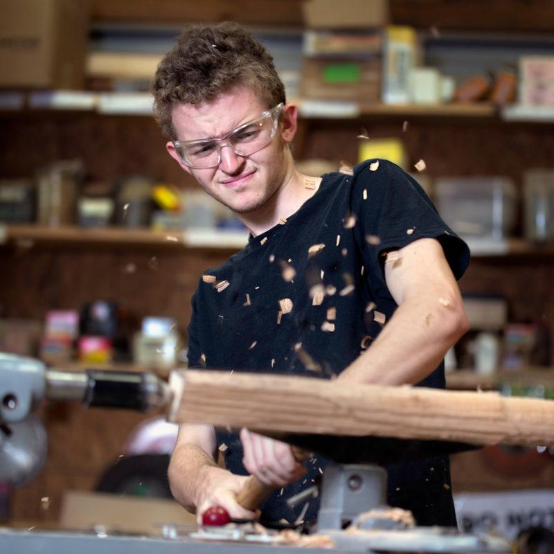 student using lathe