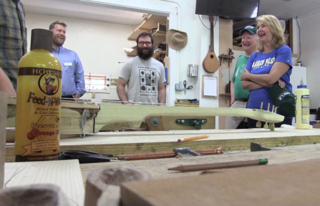 (L-R) Interim Associate Dean of Work Paul Bobbitt, Fine Woodworking Fellow Nick Falduto, board of trustees chairman Bill Christy and President-elect Lynn Morton share a laugh in the Fine Woodworking Shop.