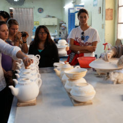 Students learning about Mexican talavera pottery