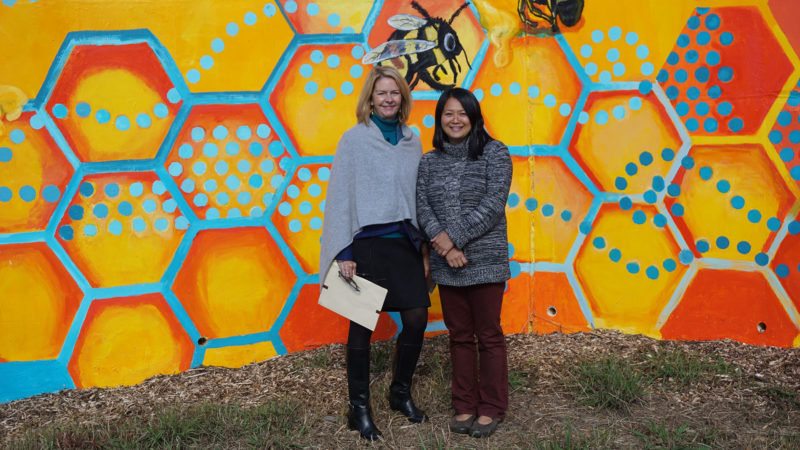 Lynn Morton and Lara Nguyen in front of mural