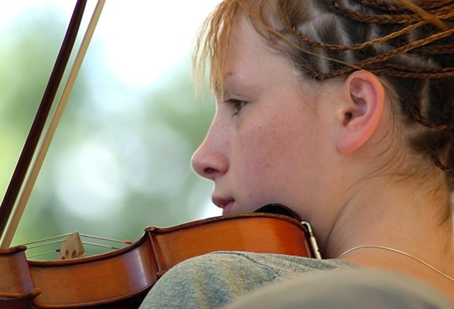 Girl playing a fiddle
