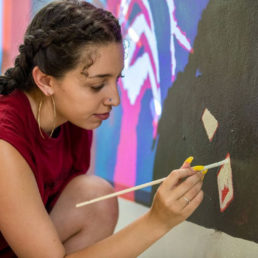 Student painting mural